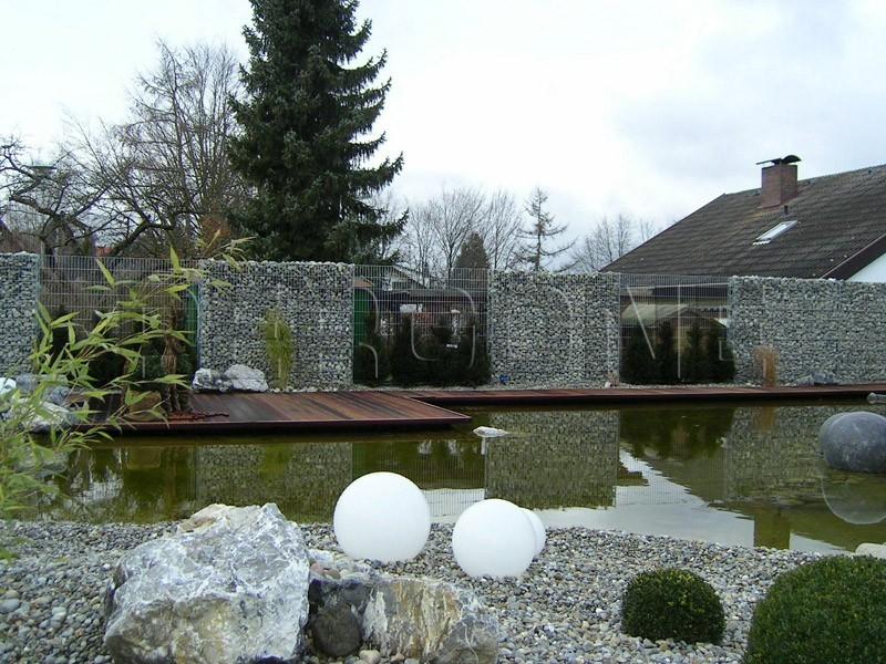 Насыпной каменный забор из габионов