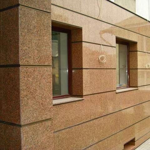Фасад из натурального камня фото